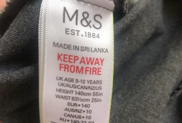 Grey M&S trousers age 9-10
